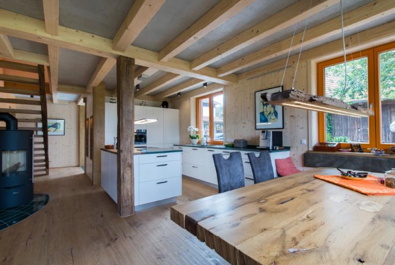 wohnen im naturreinen thoma holz100 haus frankfurt baumgarten gmbh musterhaus online. Black Bedroom Furniture Sets. Home Design Ideas
